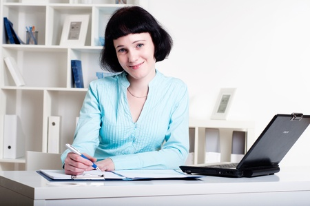 Businesswoman works at office photo