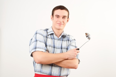 toque blanche: portrait of a young man, hold ladle Stock Photo