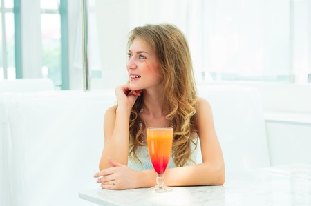 Portrait of a cute woman in urban cafe  drink beverage Stock Photo - 14737416
