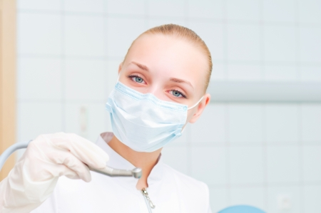 portrait of a beautiful woman dentist, to health teeth  photo