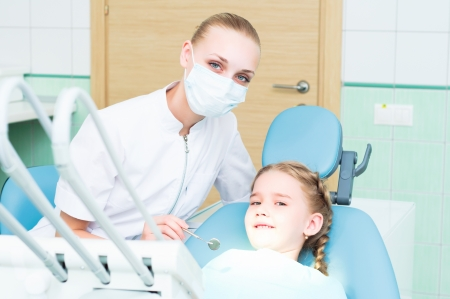 dentist inspects the child, visiting the dentist photo
