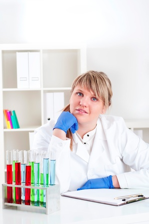 female doctor working in the lab, doing research photo