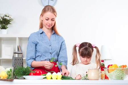 mother and daughter preparing dinner together photo