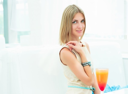 portrait of a beautiful girl in a cafe, a good time Stock Photo - 14924619