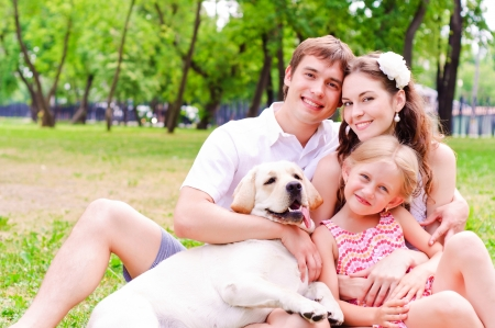 heir: Happy young family with Labrador Stock Photo