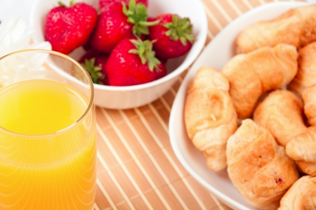 Breakfast with berries,orange juice and croissant Stock Photo - 15589356