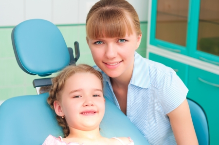 mother and daughter visit the dentist photo