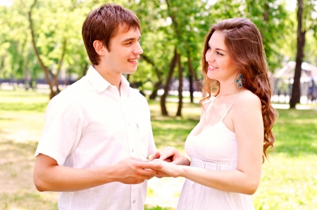 lovers holding hands: couple holding hands in the park Stock Photo