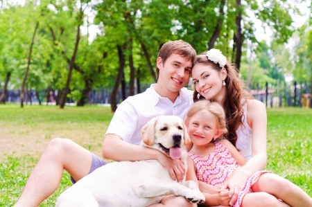Happy young family with Labrador photo
