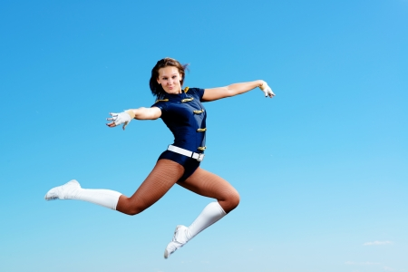 dancer jumping on a background of blue sky photo