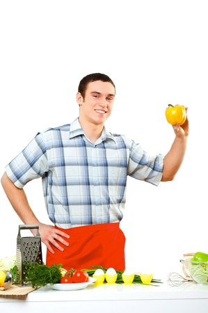 toque blanche: portrait of a young man, hold bell pepper Stock Photo