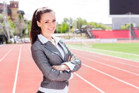 contender: portrait of a beautiful business woman at a sports stadium, the competition in the business