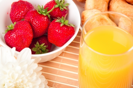 Breakfast with berries,orange juice and croissant, early breakfast Stock Photo - 16200590
