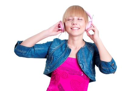 Young attractive woman listing to music with headphones against white background photo
