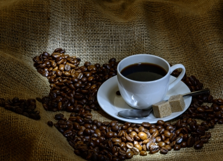 Coffee cup, beans and burlap  still life photo