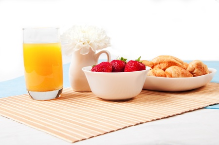 breakfast room: delicious breakfast with berries,orange juice and croissant