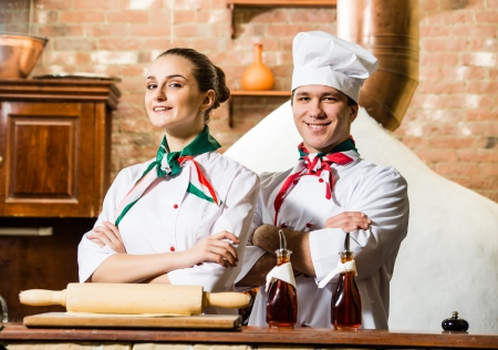 portrait of two cooks, crossing his arms and looking at the camera Stock Photo