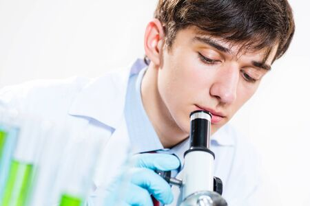 milled scientist looking into a microscope, a close-up Stock Photo - 16562950