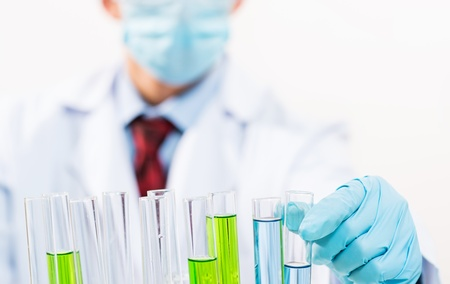scientist working in the lab examines a test tube with liquid Stock Photo - 16574021