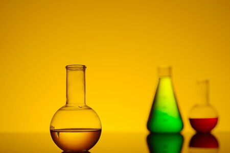 scientifical: test tubes with colored liquid, a still life, a place for text