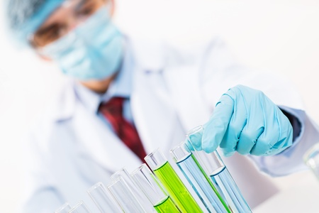 scientist working in the lab examines a test tube with liquid Stock Photo - 16592847