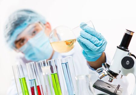 scientist working in the lab examines a test tube with liquid Stock Photo - 16669862