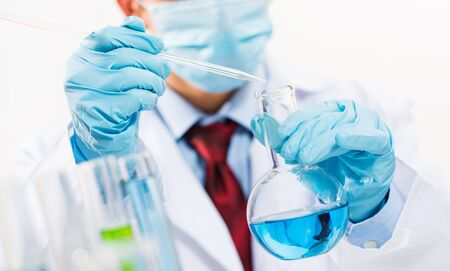 scientist working in the lab examines a test tube with liquid Stock Photo - 16880971