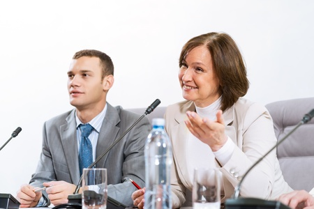 businessmen sitting in a chair at the table, communicate at the conference Stock Photo - 16880988