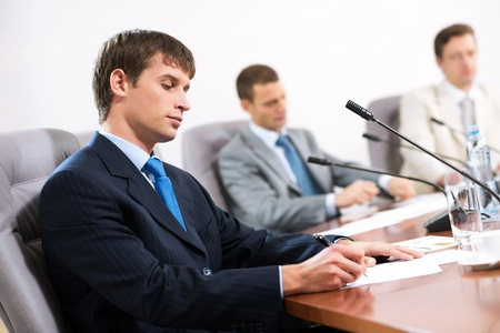 Portrait of a businessman, in the background colleagues communicate with each other Stock Photo - 16880989