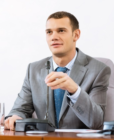 Portrait of a businessman, said into the microphone, the meeting Stock Photo - 16976609