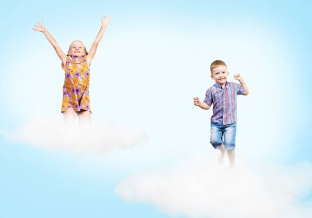 overwhite: girl and boy jumping on clouds , collage, place for text Stock Photo