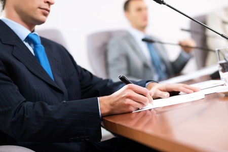 businessman taking notes, meeting businessmen at the table there are microphones and decomposition of business documents Stock Photo - 16987064