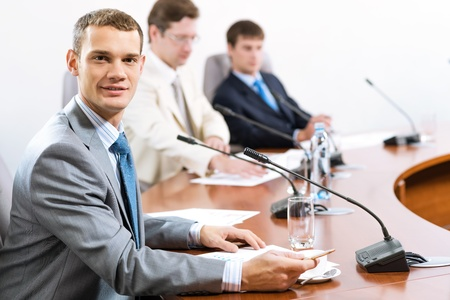 Portrait of a businessman, in the background colleagues communicate with each other Stock Photo - 17019197