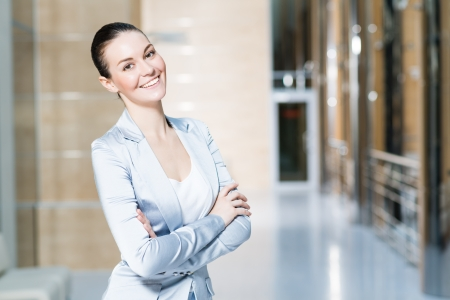 portrait of a beautiful business woman, smiling and crossed her arms Stock Photo - 17078958