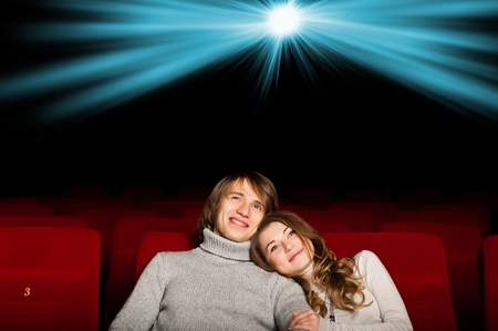 young couple in the cinema to enjoy the movie Stock Photo - 17078778