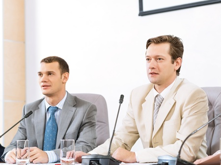 two businessmen sitting in a chair at the table, talk at the conference Stock Photo - 17078934