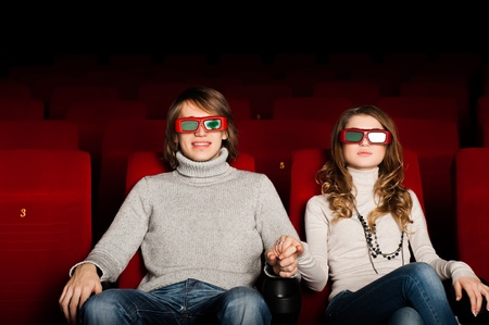 young couple in the cinema to enjoy the movie Stock Photo - 17078811