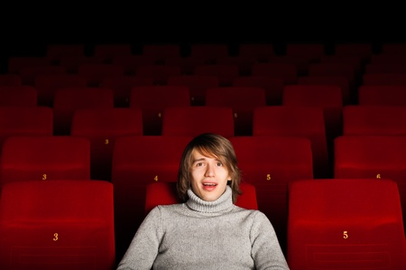 young man in casual sitting in the cinema and watching a movie Stock Photo - 17078765