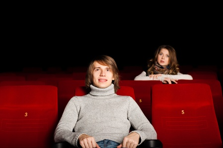 young man and woman in the cinema to enjoy the movie Stock Photo - 17078779