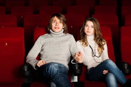 young couple in the cinema to enjoy the movie Stock Photo - 17078831