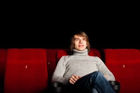 young man in casual sitting in the cinema and watching a movie Stock Photo - 17079037