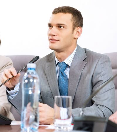 Portrait of a businessman, said into the microphone, the meeting Stock Photo - 17109914