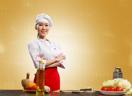 Asian cook woman crossed her arms and smiles photo
