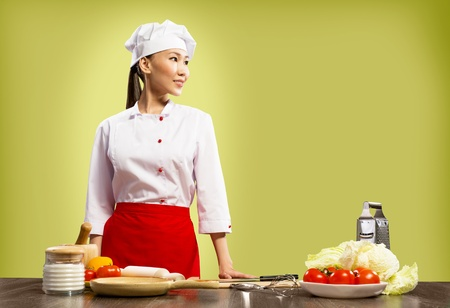 Asian female chef looking at the space for text Stock Photo - 17136966