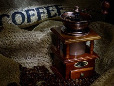 Coffee Mill with beans and burlap  still life photo