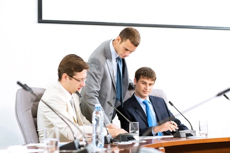 group of business people discussing documents leaning over them Stock Photo - 17136942