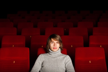 young man in casual sitting in the cinema and watching a movie Stock Photo - 17136935