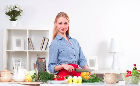 portrait beautiful woman cooking vegetables, healthy lifestyle photo