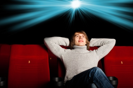 young man in casual sitting in the cinema and watching a movie Stock Photo - 17165601