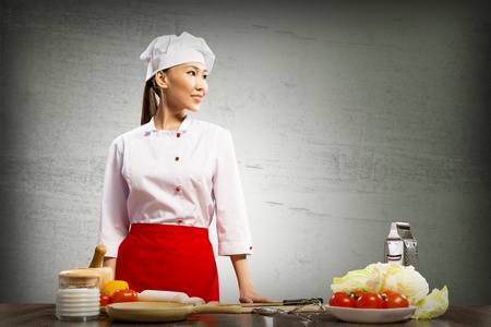 Asian female chef looking at the space for text Stock Photo - 17194087